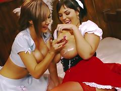 The clothes come off and the whipped cream comes out as these girls play