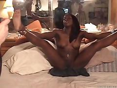 Ebony-skinned babe with stunning natural tits enjoying a hardcore interracial fuck