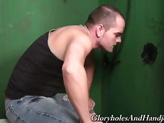 Hot dude discovers a cock through a glory hole and sucks it