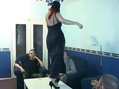 Three guys and a mature woman make for a wild foursome