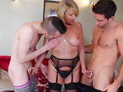 mature granny in black lingerie satisfies two guys