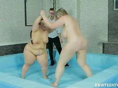 Fat wrestling babes build up a sweat and the winner gets fucked