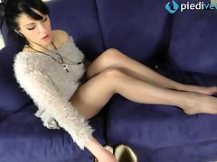 Fuzzy sweater babe with pretty feet in sheer nylons
