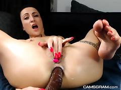 Pretty Shaved Milf Is Playing With Anal Dildo