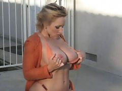 Danni ashe Orange bikini for the big boobs lovers