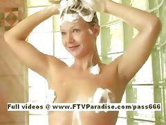 Splendid naked blonde babe taking a shower