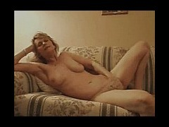 Blonde mature masturbating Blonde mature lady masturbates while laying in the sofa she looks so rela