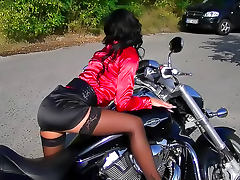 Skirt and blouse babe on bike pisses
