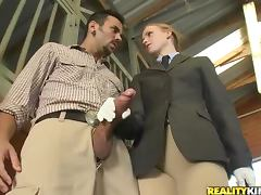 Sexy redhead laid in horse stables