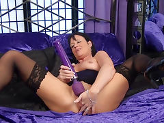 Busty milf Elise Summers is playing with a nasty toy