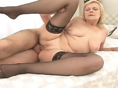 Horny old woman in stockings sucking and riding big dick