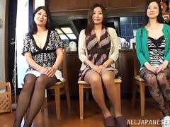 Three horny Japanese women have fun with a guy in a kitchen