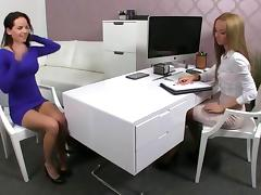 Female agent licks and fingers a brunette in her office
