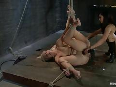Two cute blondes enjoy being tortured by Isis Love in BDSM video
