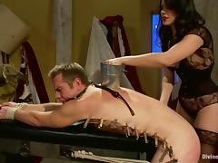 Bobbi Starr attaches clothes pegs to John Jammen's circle with the addition of fucks his ass