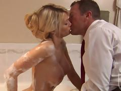 Jessica Drake gives a blowjob and gets banged in a bathroom