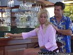 Two awesome blondes share a lucky dude's wang in a bar