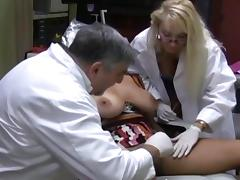 Two doctors bang a busty patient