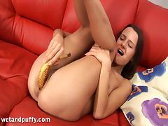 Sweet Stela Inserts A Banana Inside Her Pussy Sitting On A Couch